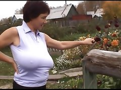 Russian huge boobs milf on her farm