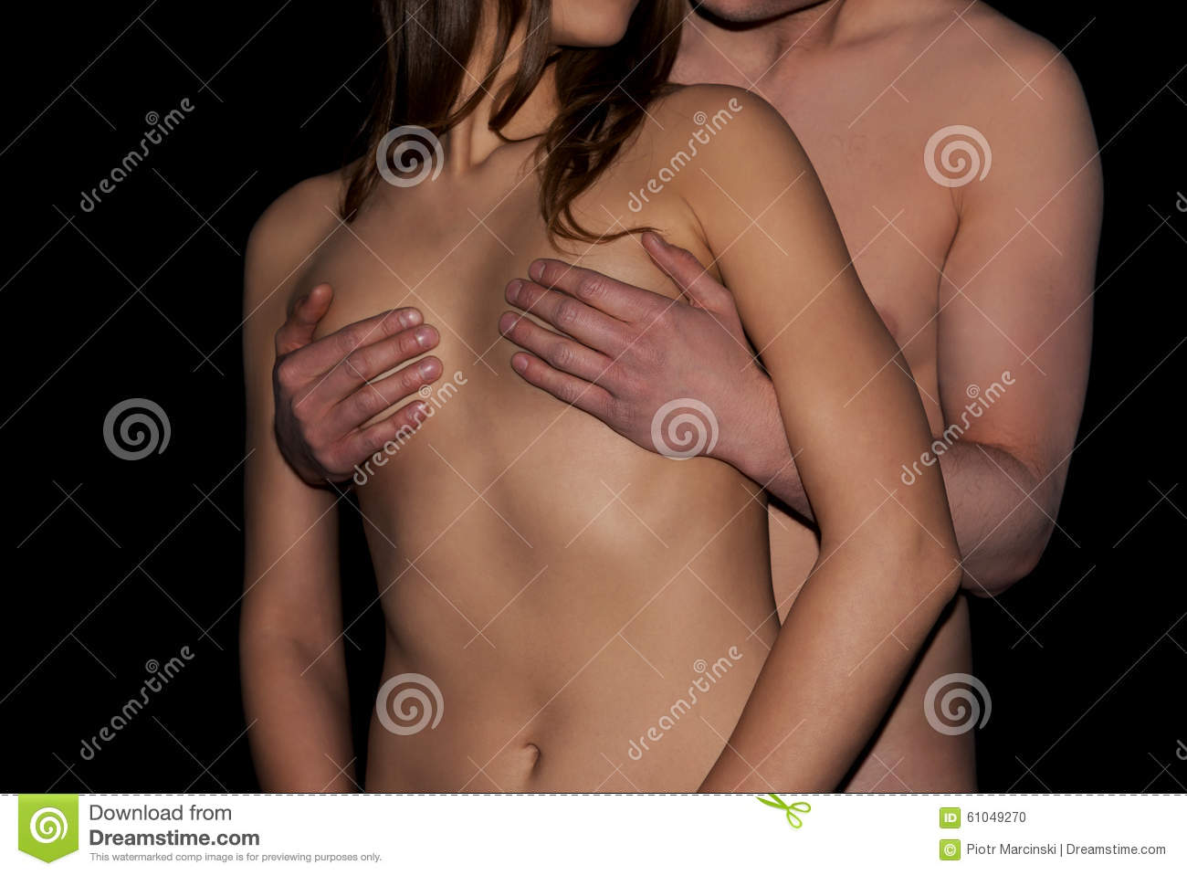 A man touches a woman s breast