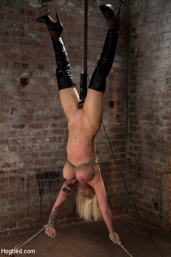 Women in bondage and suspension in boots