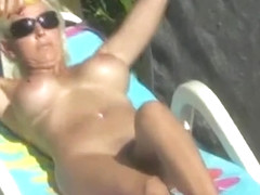 Oiled nude sunbathersurprises hubby with a blowjob