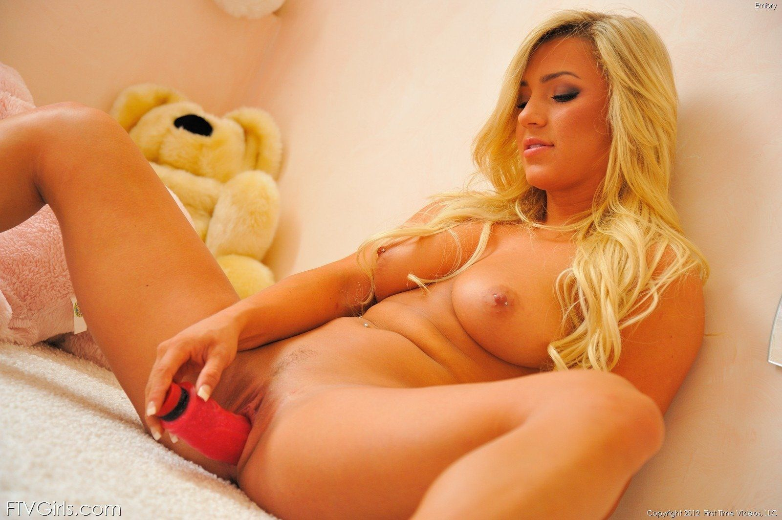 Sexy girl getting naked and using dildo