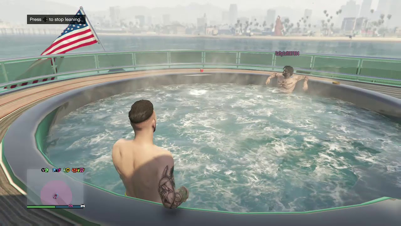 Two bros chilling in a hot tub