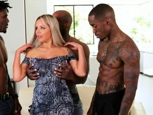 Two black men gangbang a blonde milf