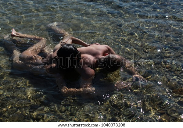 Young couple having sex near the river