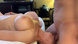 Young man getting blowjob lying in bed