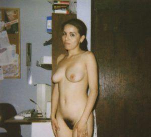 Wife giving blowjob in bedroom near mirror